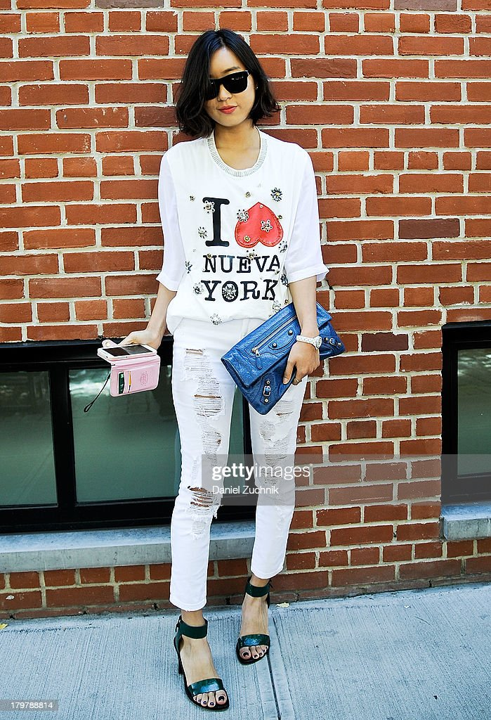 Student Young is seen outside the Duckie Brown show wearing a Phillip Lim top, Alexander Wang shoes with a Balenciaga bag on September 6, 2013 in New York City.
