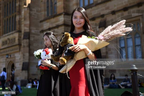 Student Zheng Zizan from Xian in China poses for family photos after graduating with a Masters of Commerce from Sydney University on October 12 2017...