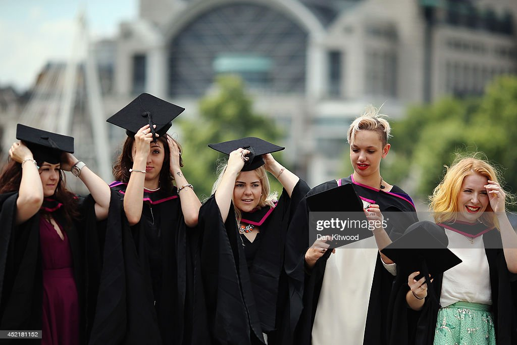 Students adjust their hats for a photograph ahead of their graduation ceremony at the Royal Festival Hall on July 15, 2014 in London, England. Students of the London College of Fashion, Management and Science and Media and Communication attended their graduation ceremony at the Royal Festival Hall today.