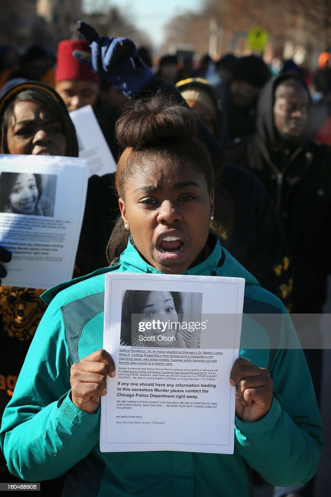 Students and community leaders march from Dr. Martin Luther King Jr. College Prep High School to Vivian Gordon Harsh Park distributing flyers which ask for help in finding the killer of Hadiya Pendleton on February 1, 2013 in Chicago, Illinois. Pendleton, a fifteen-year-old honor student at King School, was shot and killed while hanging out with friends on a rainy afternoon under a shelter in Harsh Park on January 29. A $30,000 reward has been raised to help find her killer.