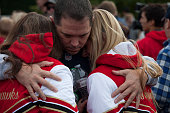 Students and family members embrace after leaving MarysvillePilchuck High School in the aftermath of a shooting on the high school's campus on...