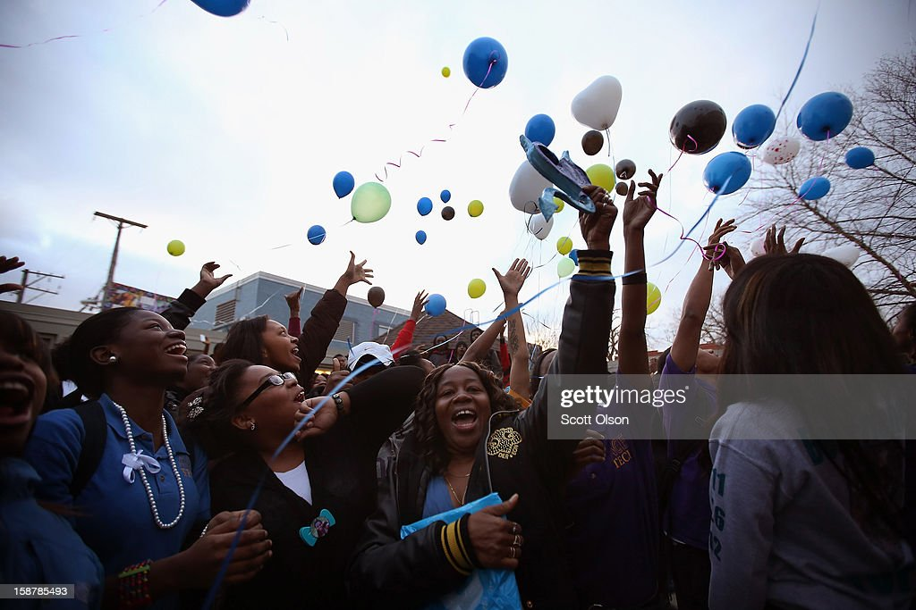 Students and family members release ballons during a memorial service for 15-year-old Porshe Foster at Ace Tech Charter High School on December 5, 2012 in Chicago, Illinois. Porshe was in the yard with three other people when someone walked by and opened fire. Police said the shooting was gang-related but that Porshe did not appear to be the intended target. On December 28, 2012, after news organizations began reporting about what was believed to be the 500th murder in Chicago this year, the Chicago Police Department's News Affairs Office issued a statement stating the city's murder total remains at 499 because classification of one death investigation remains pending. They would not specify which death is pending. The total number of murders in the city has only once exceeded 500 victims since 2004. The murder rate is up about 11 percent from 2011, much of which is attributed to growing gang violence.