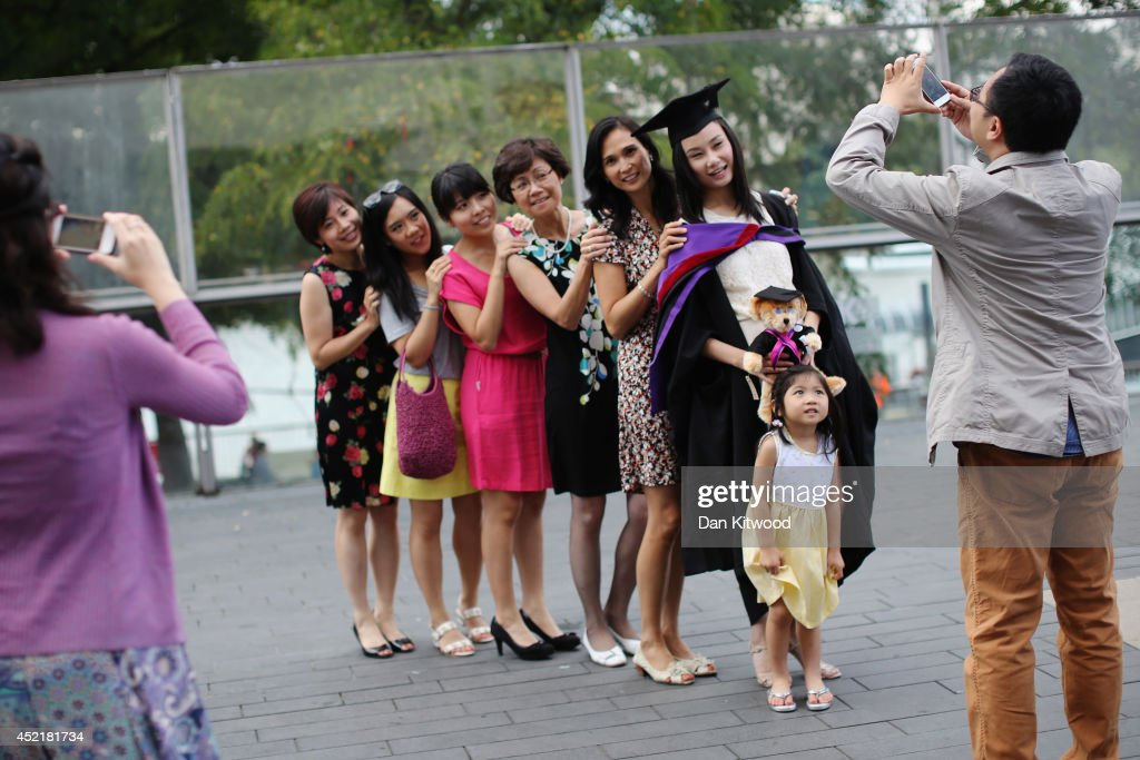 Students and family pose for photographs ahead of their graduation ceremony at the Royal Festival Hall on July 15, 2014 in London, England. Students of the London College of Fashion, Management and Science and Media and Communication attended their graduation ceremony at the Royal Festival Hall today.