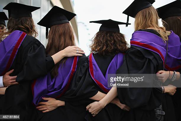 Students and family pose for photographs ahead of their graduation ceremony at the Royal Festival Hall on July 15 2014 in London England Students of...