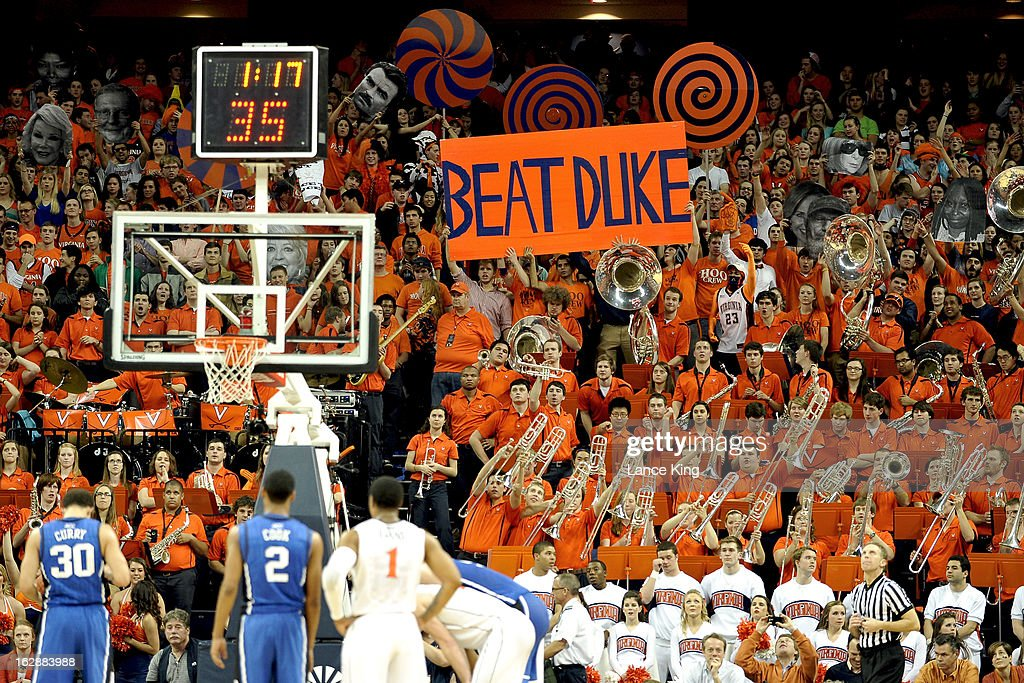 Students and fans of the Virginia Cavaliers try to distract Seth Curry #30 of the Duke Blue Devils during a free throw attempt at John Paul Jones Arena on February 28, 2013 in Charlottesville, Virginia. Virginia defeated Duke 73-68.
