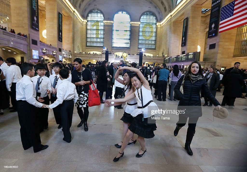Students and others gather in Grand Central Terminal beneath a '100' sign during centennial celebrations on the day the famed Manhattan transit hub turns 100 years old on February 1, 2013 in New York City. The terminal opened in 1913 and is the world's largest terminal covering 49 acres with 33 miles of track. Each day 700,000 people pass through the terminal where Metro-Noth Railroad operates 700 trains per day.