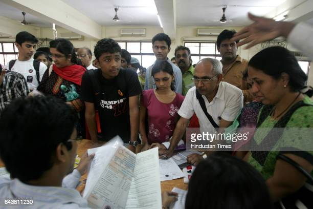 Students and parents fill forms for admission to bifocal and vocational streams as the 1st cut off list for admission to junior colleges is out at...