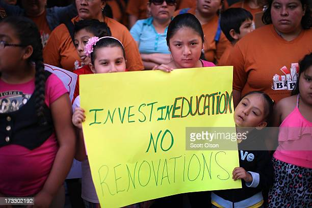 Students and parents protest outside the office of Chicago Board of Education President David Vitale on July 11 2013 in Chicago Illinois The group...