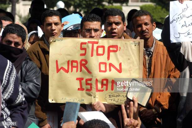 Students and professors protest the USled campaign Operation Iraqi Freedom at Cairo University March 26 2003 in Cairo Egypt Thousands of people...
