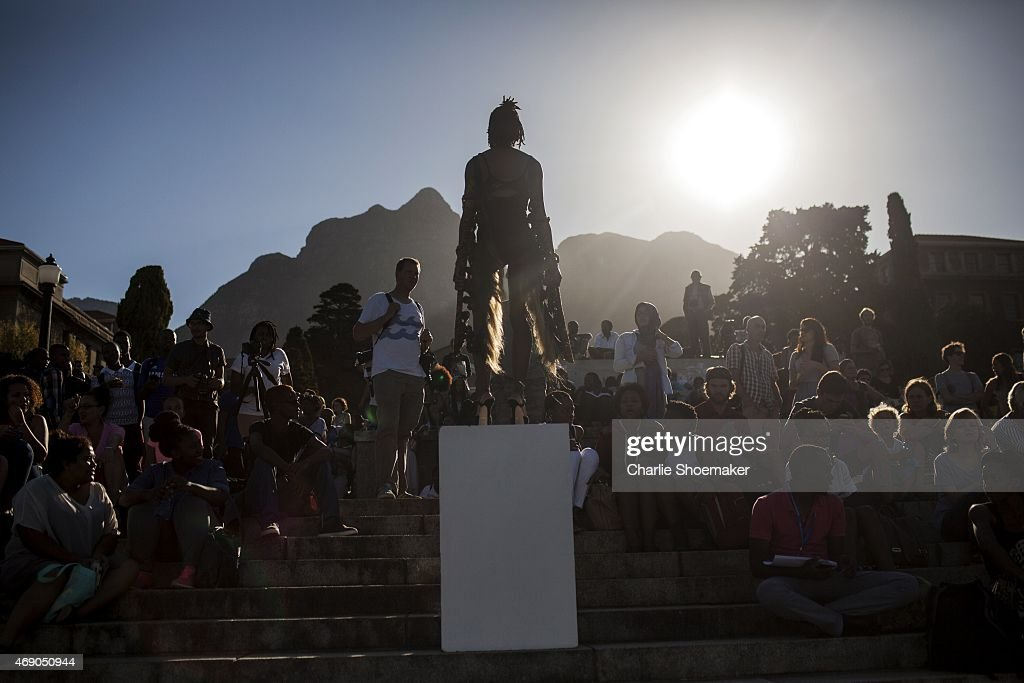 Students and protesters wait for the removal of the Cecil Rhodes statue at the University of Cape Town on April 9 2015 in Cape Town South Africa The...