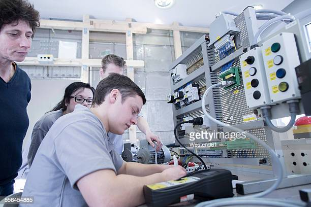 Students and teacher at electronics vocational school