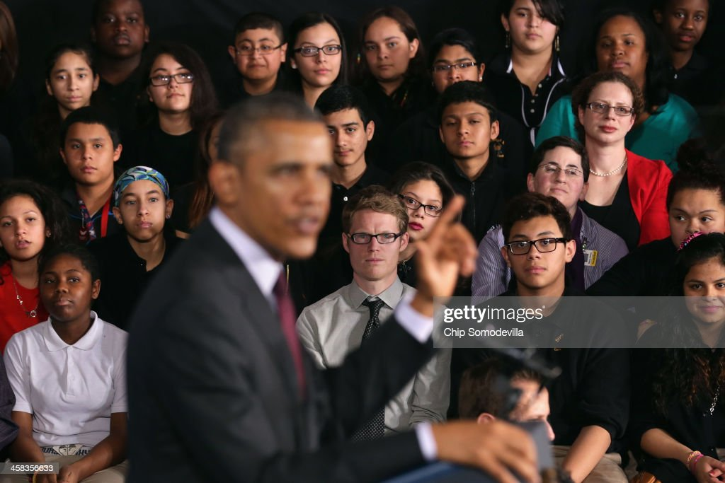 Students and teachers look on as U.S. President <a gi-track='captionPersonalityLinkClicked' href=/galleries/search?phrase=Barack+Obama&family=editorial&specificpeople=203260 ng-click='$event.stopPropagation()'>Barack Obama</a> delivers remarks about the ConnectED program at Buck Lodge Middle School February 4, 2014 in Adelphi, Maryland. As part of the president's ConnectED program, Obama has tasked the Federal Communications Commission to help to build high-speed digital connections to America's schools and libraries, with the goal of getting 99-percent of American students to next-generation broadband and wireless technology within five years.