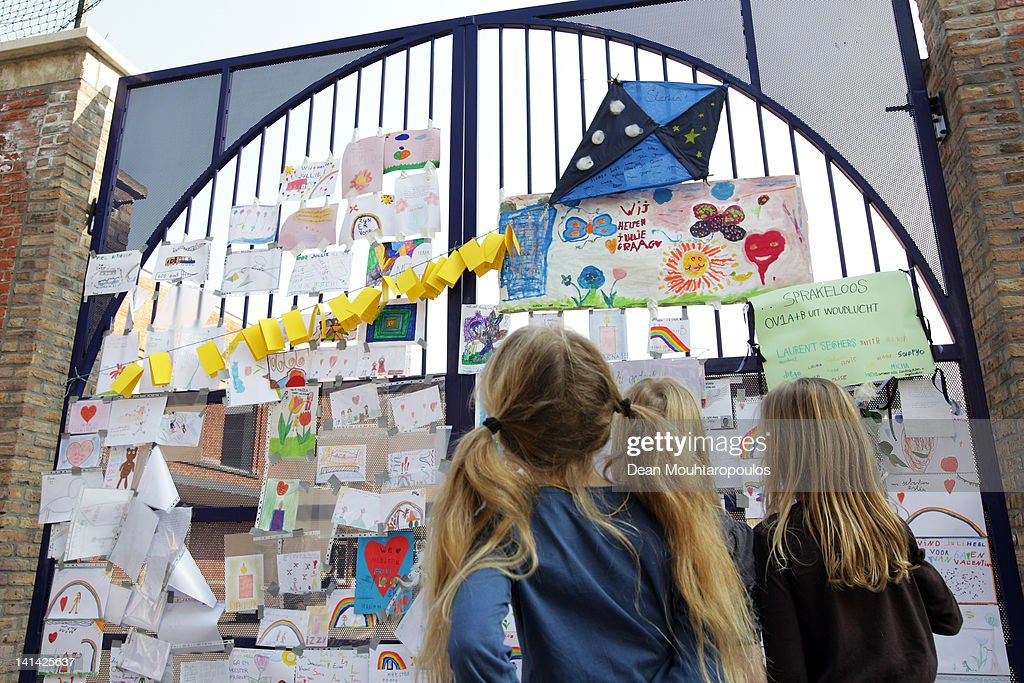 Students and teachers pay their respects at the wall of Saint Lambertus School during a national day of mourning on March 16, 2012 in Heverlee, Belgium. Belgium held a national day of mourning to remember all the who died in a coach crash earlier this week. The accident occurred when a school bus carrying 11 -12 year olds, returning from a skiing holiday, crashed into a tunnel wall, killing 28 of the 52 passengers.