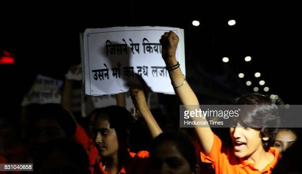 Students and teachers shout slogans during the 'Meri Raat Meri Sadak' campaign in which thousands of girls and boys from Parishkar College took out a...