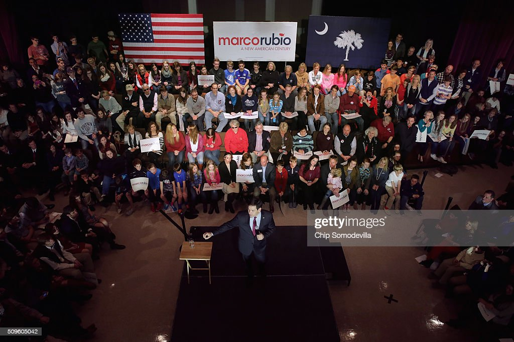 Students and their family members and guests listen to Republican presidential candidate Sen. Marco Rubio (R-FL) during a campaign town hall meeting at the February 11, 2016 in Simpsonville, South Carolina. Earlier in the week Rubio placed fifth in the New Hampshire primary, behind fellow GOP candidates Jeb Bush, John Kasich, Sen. Ted Cruz (R-TX) and Donald Trump, who won with 35 percent of the vote.