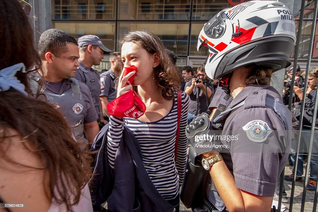 Students and their relatives react as hundreds of students from the state public schools attend a demonstration against diversion of funds for school meals in Sao Paulo, Brazil on April 28, 2016.