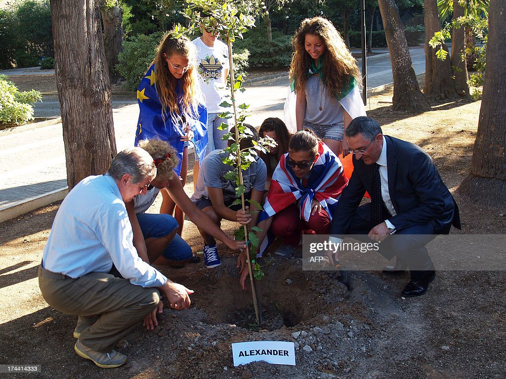 Students and their teachers of Galilei Costa High school plant one of the three trees to celebrate the birth of George Alexander Louis, the baby boy of Britain's Prince William and his wife Kate on July 25, 2013 in Lecce.