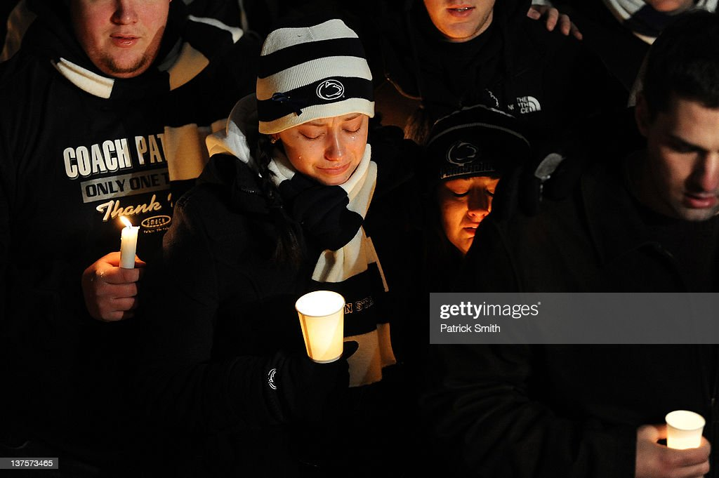 Students and those in the community embrace one another as they hold a candlelight vigil in remembrance of Joe Paterno, the former Penn State football coach who died earlier in the morning, on Old Main Lawn on the campus of Penn State on January 22, 2012 in State College, Pennsylvania. Paterno, who was 85, died due to complications from lung cancer.