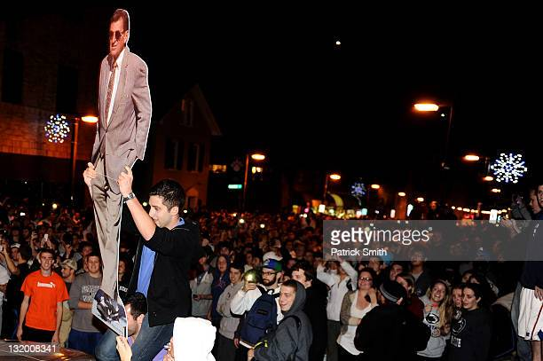 Students and those in the community fill the streets and react after football head coach Joe Paterno was fired during the Penn State Board of...