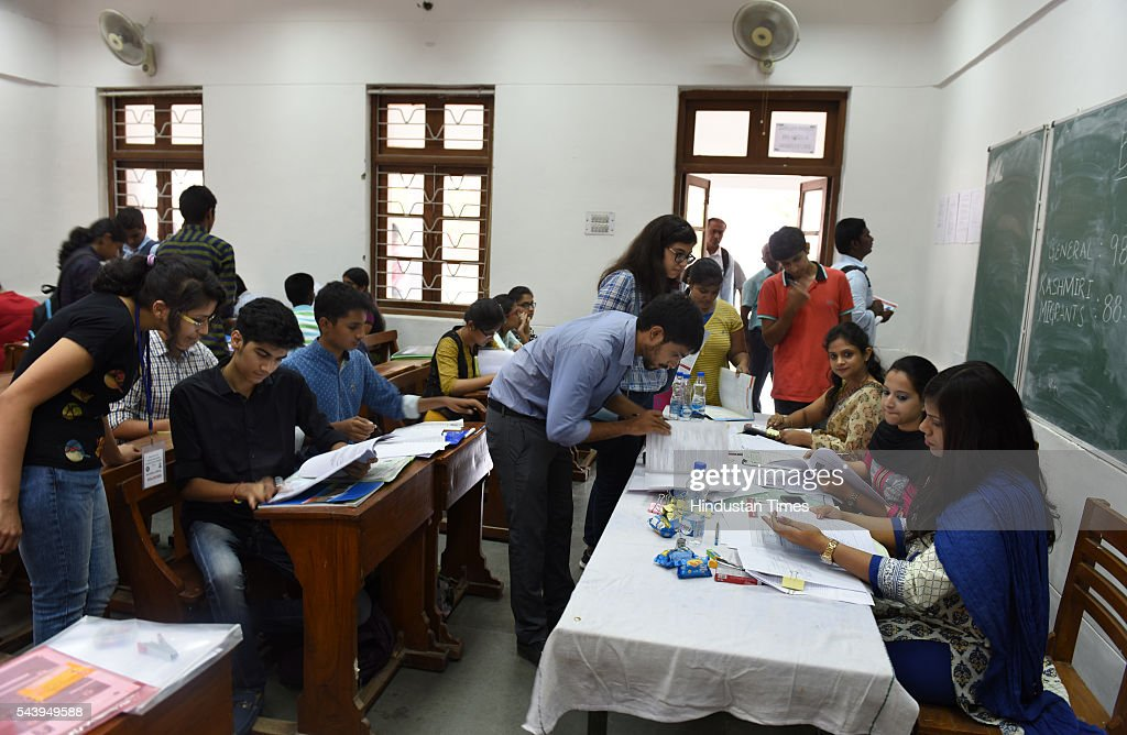 The students are busy in filling up admission forms for the new academic session 2016-17 after the first cut off list was out at Shri Ram College of Commerce at North Campus on June 30, 2016 in New Delhi, India.