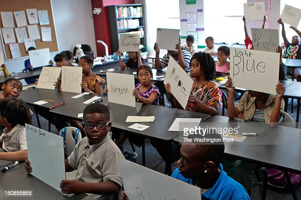 Students are taught the rules for answering questions with whiteboards by english teacher Emily Culp during the opening of a BASIS charter school a...