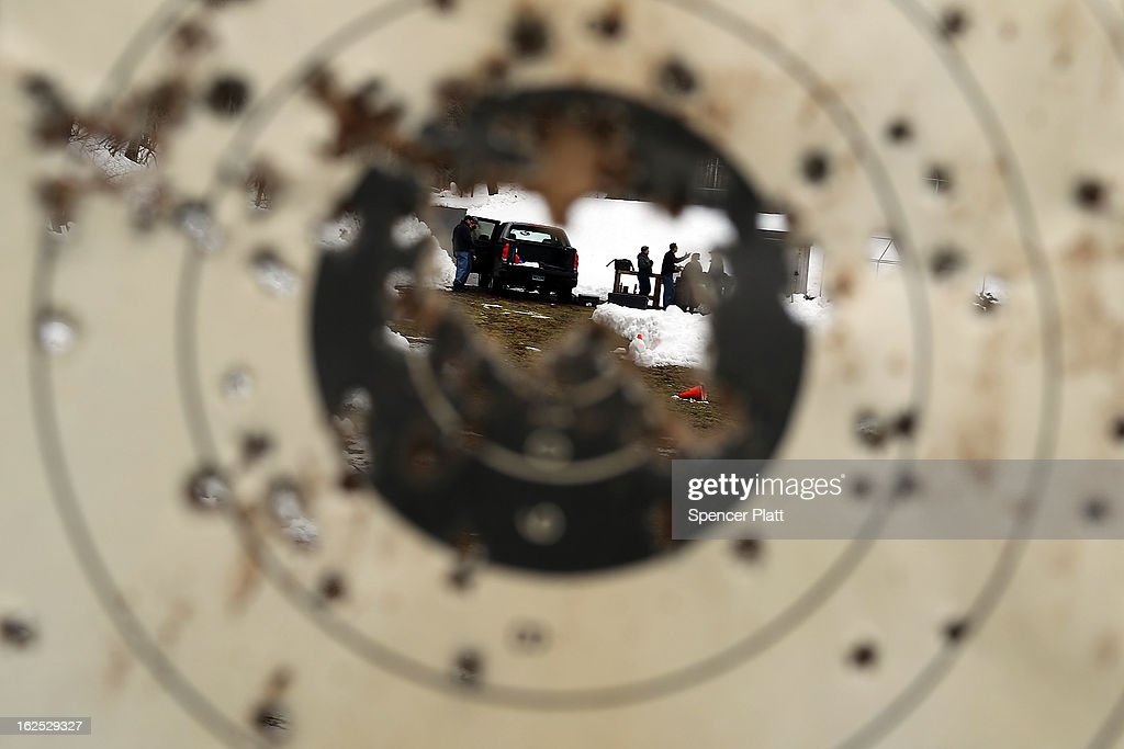 Students are viewed through a target at a class taught by King 33 Training at a shooting range on February 24, 2013 in Wallingford, Connecticut. King 33 Training, a company that trains and educates individuals on the safe and proper use of guns and other uses of protective force, offers classes to marksmen of all levels. The Connecticut company offers training for clients interested in maintaining a safe environment for themselves, their families, and those around them. Connecticut, home to a number of gun manufactures including Colt Defense, is a state with conflicting views on guns and gun ownership. Currently the state has some of the strictest gun control laws in the nation and its current governor Daniel Malloy is pushing for tougher measures following the shootings at the Sandy Hook School.