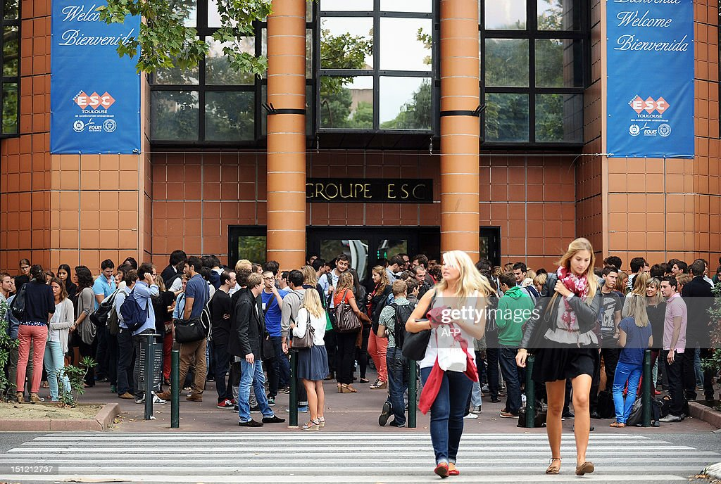 Students are waiting around past Toulouse's ESC business school on September 4, 2012, before the start of the new school year in Villefranche-de-Lauragais, southwestern France.