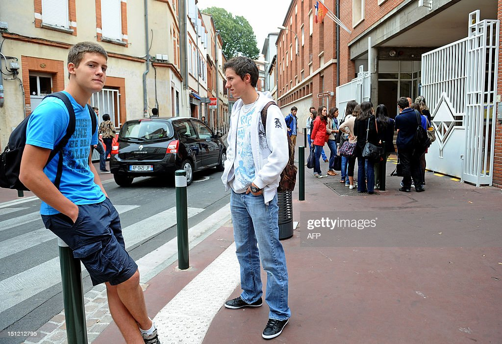 Students are waiting past the Ozenne high-school on September 4, 2012, in Toulouse, southwestern France, before the start of the new school year.
