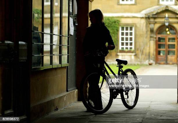 Students arrive for lectures at Trinity Hall University Cambridge on the day higher education finance reforms announced students can expect to leave...