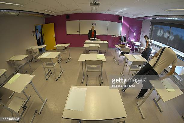 Students arrive in a classroom to take the philosophy exam the first test session of the 2015 baccalaureate on June 17 2015 in Marseille southern...