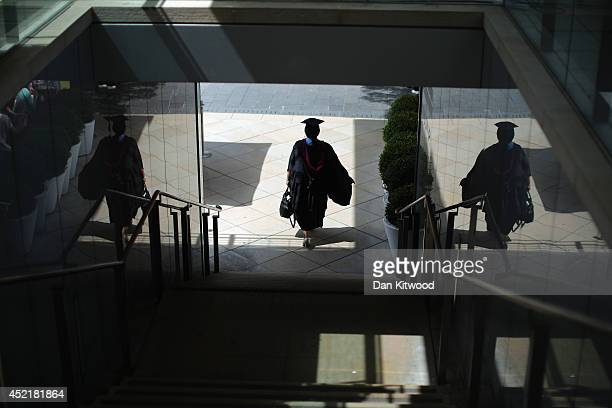 Students arrive on the South Bank ahead of their graduation ceremony at the Royal Festival Hall on July 15 2014 in London England Students of the...
