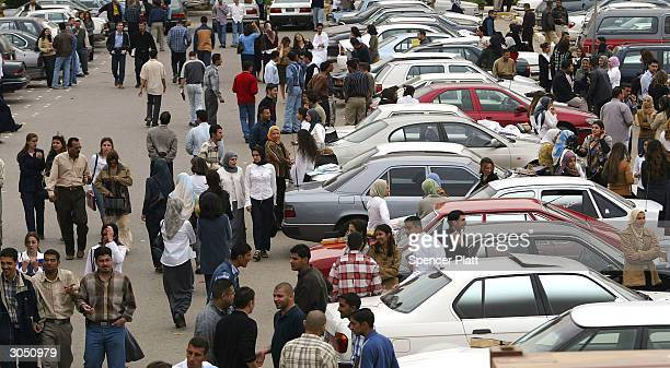 Students at Baghdad University mingle in the parking lot March 7 2004 in Baghdad Iraq Baghdad University the nation's largest college has now been...
