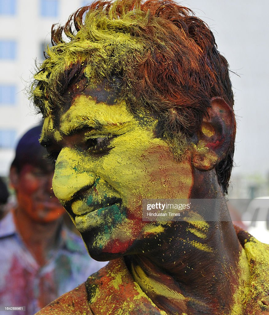 Students at Design and Innovation Academy (DIA) celebrating Holi ahead of the festival which will be celebrated across country on March 27, at Sector 62, on March 21, 2013 in Noida, India. Holi marks the arrival of spring & end of the winter season.