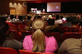 Students at Fitch Senior High School listen during a presentation in the school auditorium to educate them about the dangers of opioid painkiller...