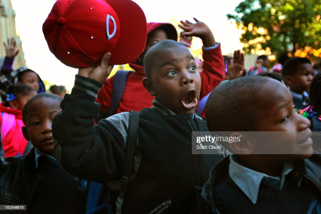 Students at Frazier International Magnet School wait outside before the start of school on September 19, 2012 in Chicago, Illinois. Today was the first day back at school for about 350,000 Chicago public school children after more than 26,000 teachers and support staff walked off of their jobs on September 10 after the Chicago Teachers Union failed to reach an agreement with the city on compensation, benefits and job security.