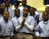 Students at Harlem Village Academy Charter School celebrate their high scores on last spring's seventhgrade math test