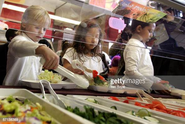 Students at Nettelhorst Elementary School on lunch dig into a salad bar in the school's lunchroom March 20 2006 in Chicago Illinois US Senator Dick...