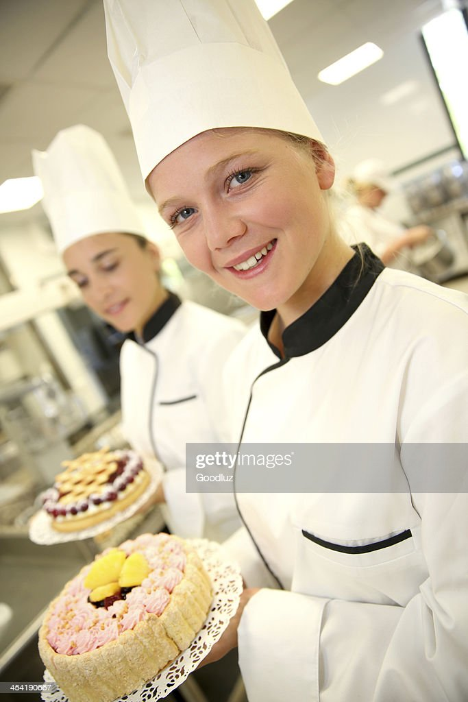 Students at school proud of their cakes : Stock Photo