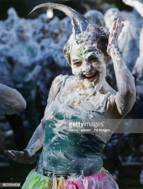 Students at St Andrews University take part in a foam fight in St Salvator's Quad as part of the Raisin Day celebrations