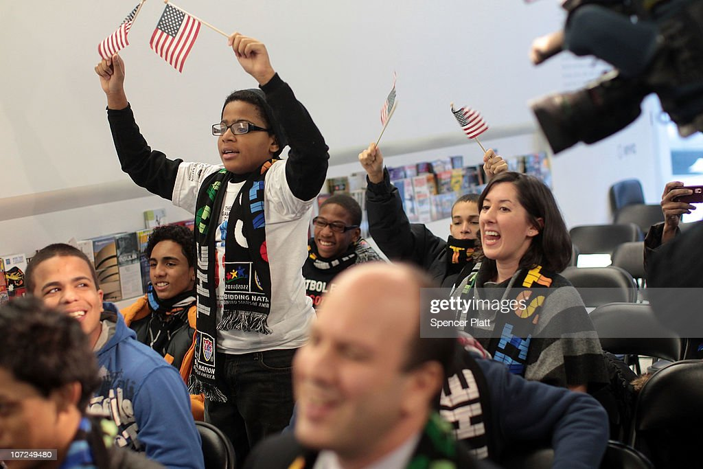 Students at the Business of Sports School wait for the announcement of the winner of the bid to host the 2022 World Cup on December 2 2010 in New...