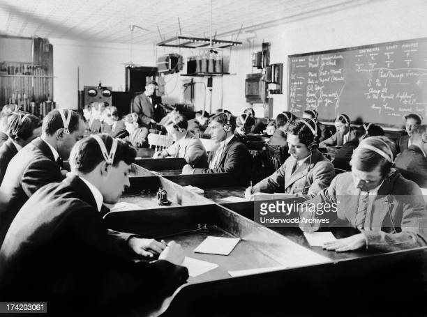 Students at the first Marconi Wireless School in the United States in New York 1916 The new law after the Titanic disaster requiring operators to be...