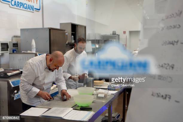 Students at the Gelato University during a course at the Carpigiani complex on March 28 2017 in Bologna Italy Italian brothers Bruto and Poerio Carlo...