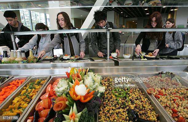 Students at the University of California Berkeley build salads from a salad bar with organic vegetables at UC Berkeley's Crossroads dining commons...