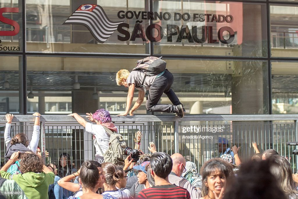 Students attempt to enter Sao Paulo State Government as hundreds of students from the state public schools attend a demonstration against diversion of funds for school meals in Sao Paulo, Brazil on April 28, 2016.