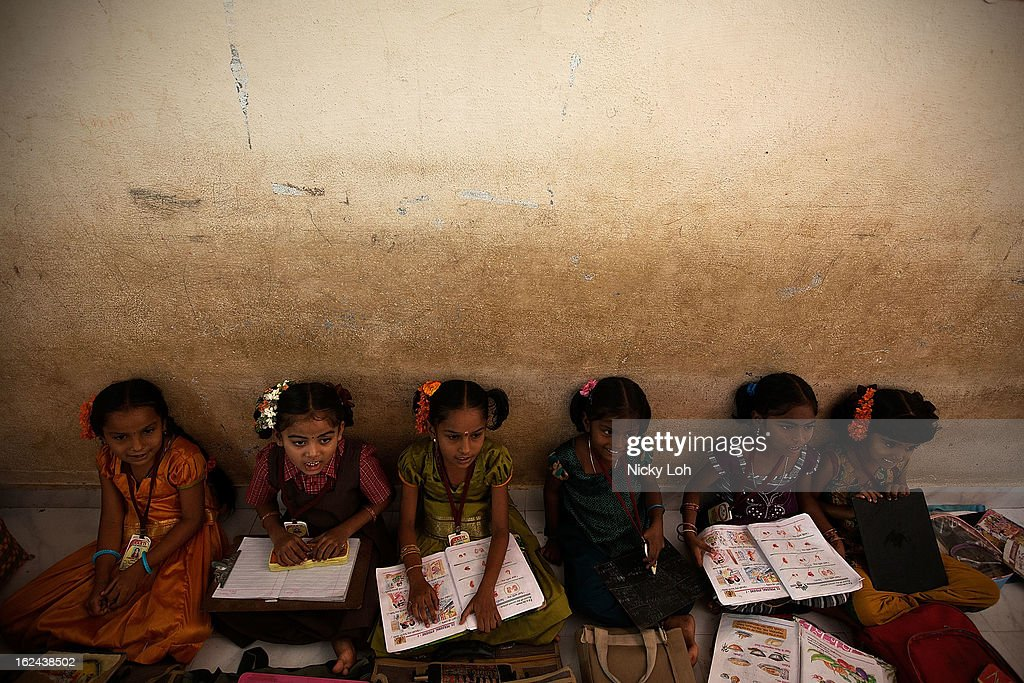 Students attend a class at the Aarti Home shelter on February 23, 2013 in Kadapa, India. Female infanticide is still prevalent in rural areas of India. The abuse of the dowry tradition has been one of the main reasons for sex-selective abortions and female infanticides in India.