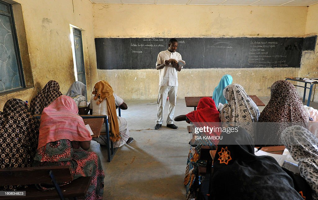 Students attend a class on the first day of the reopening of schools after the French bombing of Islamist targets, on February 4, 2013 in Gao, in the north of Mali. Schools reopened today in Gao after the town was taken on January 26 by French and Malian forces from Islamists who had been occupying it for the last year.