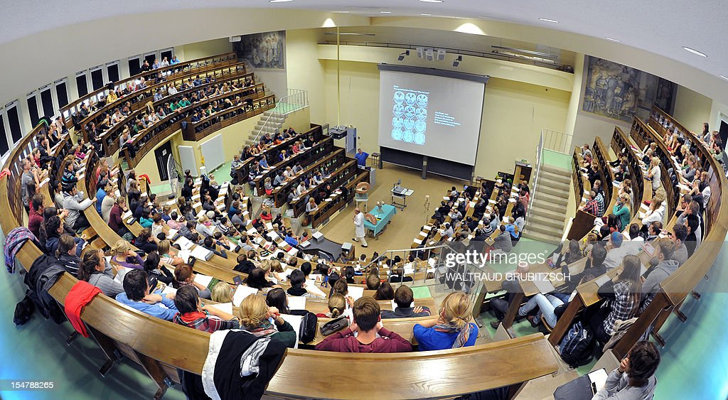 Students attend a lecture at the historic auditorium at the anatomical institute of the university in Leipzig, eastern Germany on October 18, 2012. More than 7000 students matriculates this year in Leipzig as the university stated.