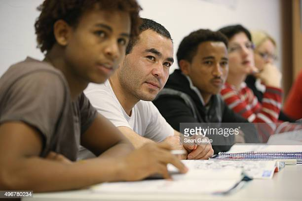Students attend an intermediate German language class for migrants and refugees from countries including Eritrea Afghanistan Iran Chechnya and...