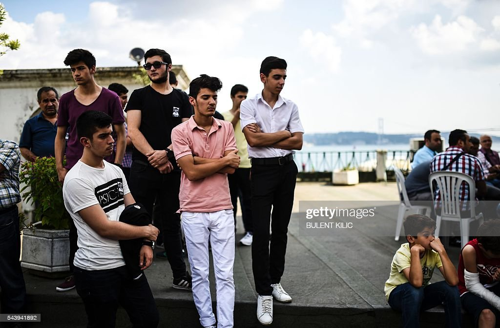 Students attend he funeral of Turkish teacher Huseyin Tunc in Istanbul on June 30, 2016 two days after the triple suicide bombing and gun attack occurred at Istanbul's Ataturk airport. Turkey on June 30 detained 13 suspected Islamic State jihadists over the deadly Istanbul airport attack, as chilling details emerged of how suicide bombers launched their assault. The death toll from the triple suicide bombing and gun attack that occurred on June 28, 2016 at Istanbul's Ataturk airport has risen to 44 including 19 foreigners. / AFP / BULENT
