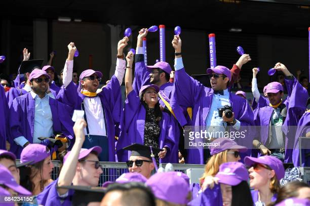 Students attend the New York University 2017 Commencement at Yankee Stadium on May 17 2017 in the Bronx borough of New York City